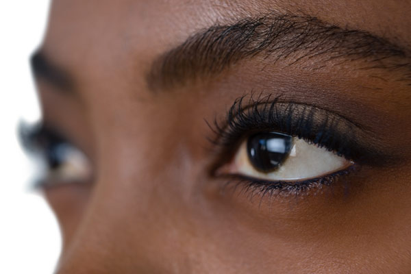 Close up of a woman's dark brown  eyes