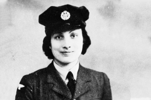 Black and white photo from the 40's of   Noor Inayat Khan in uniform
