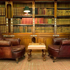 Two leather chairs in an old library