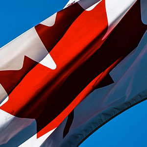 Photograph of a Canadian flag blowing in the wind