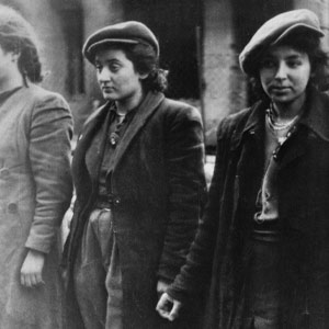 Black and white photo of three Polish women in the Warsaw Ghetto
