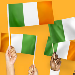 Illustration of a number people waving an Irish flag