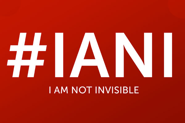 Hashtag IAMI - I am Not Invisible, on a red background