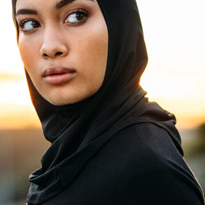 A woman standing outside looking back with concern