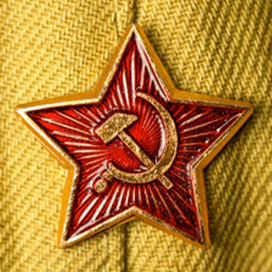Old soviet military badge with hammer and sickle on light green cloth