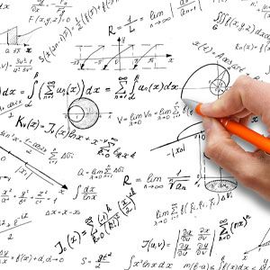 A hand drawing complicate math equations on a white board